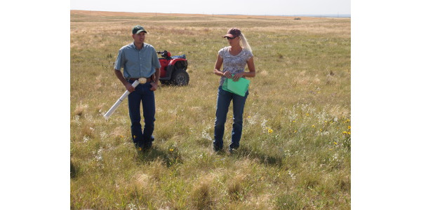 Ranchers Jay and Krista Reiser discuss their grazing system during the field component of a North Dakota Grazing School. (NDSU photo)
