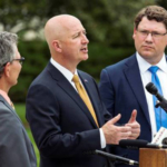 Governor Ricketts with (from left to right) DOT Deputy Director of Operations Moe Jamshidi and DOT Director Kyle Schneweis at a July 5th news conference in Lincoln announcing record setting infrastructure investments for Nebraska. (Courtesy of Office of Governor Pete Ricketts)