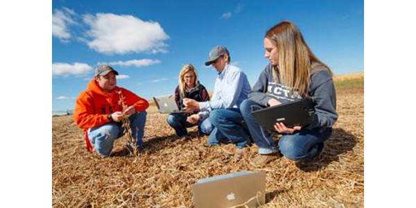 Students at the Nebraska College of Technical Agriculture in Curtis evaluate crop residue at the campus farm. Two of the NCTA graduates are pursuing 4-year degrees at the University of Nebraska-Lincoln. (Craig Chandler, NCTA)