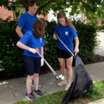 Kentucky 4-H'ers from left: Kayla Mohon, Ohio County, Raymond Carter, Lawrence County, and Debbie Myers, Campbell County, pick up litter in a downtown Lexington neighborhood as part of their community service project with Bluegrass Greensource. Photo by Katie Pratt, UK agricultural communications. (Courtesy of University of Kentucky)