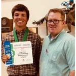 Camden Wilke of Columbus will begin his college career at NCTA in August. He visits with NCTA Animal Science professor and judging team coach Doug Smith after winning a livestock judging contest in Lincoln. Wilke is one of many Aggie recruits who visited campus and registered for classes at NCTA for 2018-2019. (NCTA photo)