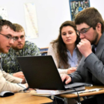 NCTA Ag Business students competed in a national contest in April, 2018, for two-year agricultural colleges. From left, Cody Most, Riley Abbott, Erica Mowery and Nate Letcher, review a contest project. Abbott, Mowery, and Letcher were third-year double majors who graduated with honors on May 3. (Photo by Northeast Community College)