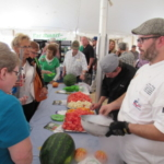 Chef Josh Kranz and students from the Mitchell Technical Institute Culinary Academy serving up liquid nitrogen cooled fruit skewers of Forestburg muskmelon and watermelon at Value Added Ag Center Day 2017! (Courtesy of SDSPA)