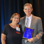 Brian Meyer (right) is presented the 2018 ACE Professional Award on August 7 by Suzanne Steel, ACE president during the association's annual conference in Phoenix, Arizona. The Professional Award is the highest honor presented by the association. (Courtesy of ISU)