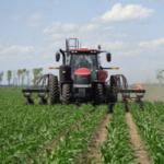 NDSU reseachers interseed cover crops in a field plot near Rutland. (NDSU Photo)