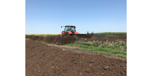 Carpio-area producer Monte Bloms turns compost rows in preparation for the Manure Compost Demo Day. (NDSU photo)