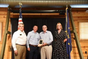 Lt. Governor Suzanne Crouch and ISDA Director Bruce Kettler presenting Tim and Jim Craig with James Allen Insurance with the AgriVision Award.