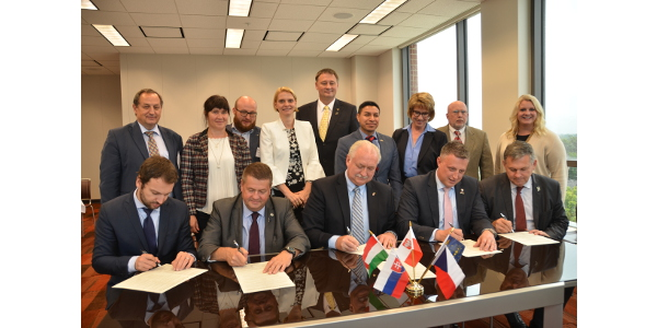 Signing from left to right are Jan Dolezal (representing the Agrarian Chamber of the Czech Republic), Miroslaw Borowski (representing the National Council of Agricultural Chambers in Poland), Randy Kron (Indiana Farm Bureau President), Balázs Györffy (representing the Hungarian Chamber of Agriculture) and Oliver Siatkovky (representing the Slovakian Chamber of Agriculture and Food). (Courtesy of Indiana Farm Bureau)