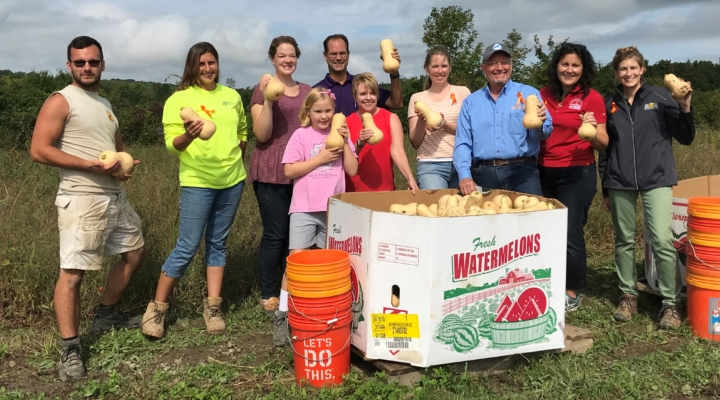 Volunteers work to Squash Out Hunger