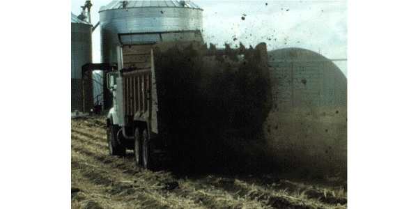 Watching a weather forecast before land applying manure can reduce your neighbors' odor exposure. (Photo courtesy of Rick Koelsch)
