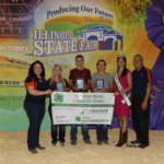 Top 3 finishers in the 2018 Illinois 4-H State Dairy Judging Contest at the Illinois State Fair in Springfield, IL this August. Individuals pictured (left to right) are: Lisa Diaz, University of Illinois Extension 4-H state program leader; Taylor Huels of Bond County, Jacob Raber, Livingston County, Addison Raber, Livingston County, Miss Illinois County Fair Queen Samantha Hasselbring; and Dave Fischer, Extension 4-H dairy program coordinator. (University of Illinois Extension)