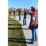 The Aggie Shooters receive trap shooting tips from Britt Dalton, who was helping the trap squad at a recent workout (Mary Crawford/NCTA News)