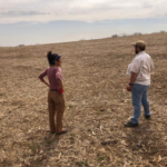 Landowner Chele Isaac and Conservationist Landon Baumgartner discuss conservation planning options. (Courtesy of Southwest Badger RC&D Council)