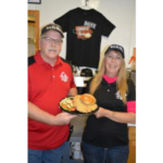 Steve and Missy Sanson, owners of the Three C's Diner in Corning, show off their 2018 award-winning breaded pork tenderloin. They received the Best Breaded Pork Tenderloin award from the Iowa Pork Producers Association. (Courtesy of IPPA)