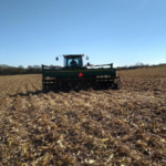 Figure 1. Drilling cereal rye into corn stubble in Dodge County, October 19, 2018. (Photo by Katja Koehler-Cole)