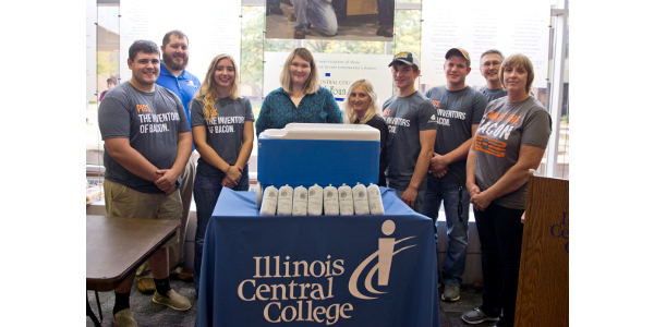 The Illinois Pork Producers Association has partnered with ICC Agriculture program to donate 100 lbs. of ground pork to the ICC Food Pantry. Pictured (left to right): Zach Wamsley, Rensselaer, Ind. (student); Mike Borgic, IPPA Membership Director; Kylie Cagwin, Edwards, Ill. (student); ICC Counseling Coord. Amy Daxenbichler; ICC Access Services Coord. Terri Ingles; Clay Kretzmeier, Benton, Ind. (student); Clayton Blunier, Speer, Ill. (student); ICC Ag Program Professor Grant Grebner; Pork Producer Pam Janssen of Minonk, Ill. (Students are all officers in ICC Agri-Business Club.) (Courtesy of Illinois Pork Producers Association)