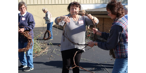 Jo Daviess County Master Gardener Linda Helgeson instructs participants on how to wrap the grapevines into a wreath. (Courtesy of University of Illinois Extension)