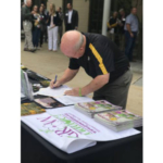 Pete Millier, Director of Campus Facilities—Landscape Services and the Mizzou Botanic Garden signs pledge to stop the spread of invasive species on MU's campus. (Courtesy of University of Missouri)