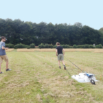 Algeo stands on the left with a tablet while his advisor, Lee Slater, drags ground penetrating radar equipment over the soil's surface. Photo credit Chris Watts, Rothamsted Research. (Courtesy of ACSESS)