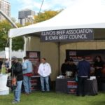 Chef Dave Zino, Executive Chef, National Cattlemen's Beef Association, a contractor to the Beef Checkoff, greets attendees of the Chicago Gourmet Food and Wine event September 28-30. (Courtesy of Iowa Beef Industry Council)