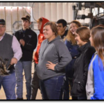 North Platte students observe Dr. Doug Smith demonstrate equipment for processing cattle during health checkups at the NCTA Red Barn. The students visited campus last fall to learn animal science skills. (NCTA file photo)