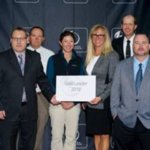 Mountain Prairie, LLC employees (left to right) Kelvin Wollert, Jim Fiala, Ben Miller, Marguerite Tan, Lynette Myers, ELP Executive Director, Kep Proctor, John Lofdahl and Ron Schmidt receive the Gold Leader Award. (Courtesy of CLA)