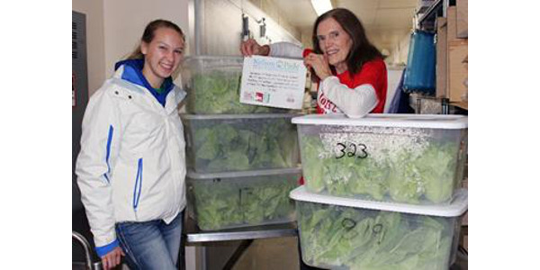 Carol (right) with Montello School District, accepting their complimentary lettuce delivery from Nelson and Pade, Inc. team member, Tiffanie (left). (Courtesy of Nelson and Pade)