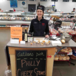 Hy-Vee dietitian sharing easy beef recipe with customers for National Family Meals Month promotion in September. (Photo courtesy of Hy-Vee)