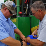 Seaman and Rohleder bagging seed from one of the many plots at the Hays Agriculture Research Center. (Courtesy of Kansas Wheat Alliance)