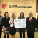 A $6,100 donation check is presented to the Fred & Pamela Buffett Cancer Center on behalf of 24 retail locations that participated in Fuel the Cure during October. From left, Roger Berry, director of market development with the Nebraska Corn Board; Sarah Caswell, administrator of the Nebraska Ethanol Board, Ashley Christensen, University of Nebraska Foundation director of development for the Buffett Cancer Center; Megan Grimes, program manager with the Nebraska Ethanol Board; Jan tenBensel, chairman of the Nebraska Ethanol Board; Scott McPheeters, vice-chairman of the Nebraska Ethanol Board. (Courtesy of Nebraska Ethanol Board)