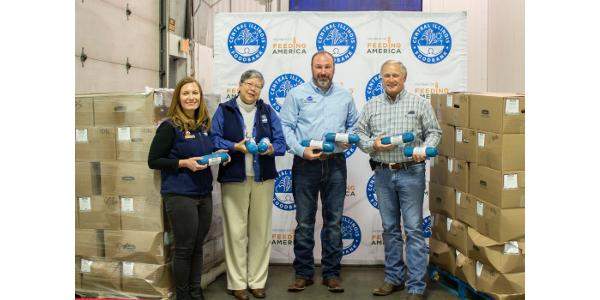 From left: Virginia Ferguson, Central Illinois Foodbank; Pam Molitoris, Central Illinois Foodbank; Dereke Dunkirk, Illinois Pork Producers Association; Marty Marr, Illinois Corn Marketing Board. (Courtesy of Illinois Pork Producers Association)