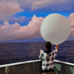 Atmospheric Science graduate student Kyle Chudler releases a weather balloon from the deck of the R/V Thompson. (Courtesy of CSU)