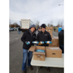 (L) Ryan Farmer, St. Louis Area Food Bank, and Paul Ayers, Illinois Pork Producers Association District 10 Director, help unload 6,000 pounds of ground pork donated by Illinois pig farmers. (Courtesy of IPPA)
