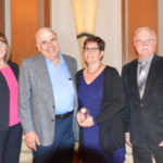 Sharon Toth (left), UDIM CEO, and Jim Reid (right), UDIM president, with Bill and Carolyn Shuler (center), recipients of the 2018 Excellence in Agriculture Award. (Courtesy of United Dairy Industry of Michigan)