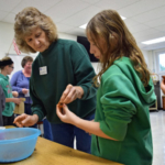 Students at V.I.T. Elementary made seed balls containing milkweed and native prairie seeds to plant this fall with Master Naturalist Cindy Intravartolo. U of I Extension was one of many partners teaching at the Youth Pollinator and Conservation event coordinated by McDonough County Quail Forever. (Courtesy of University of Illinois Extension)