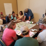 Participants in NDSU Extension's North Dakota Soil and Water Conservation Leadership Academy work on a hands-on exercise. (NDSU photo)