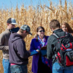 Agribusiness Management Systems students discuss financial returns with AMS Professor Mary Rittenhouse at the NCTA field lab near campus. (Craig Chandler, University Communication)