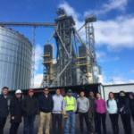 USDA Cochran Fellowship Program participants visit The DeLong Co., Inc., a container loading facility in Edgerton, Kansas, to learn about grain exports, shipping, handling and receiving. (Courtesy of KSU-IGP Institute)