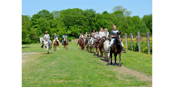 Cast and crew members of Transformative Travels ride horses at the Rocking U Riding Stables at Wrangler Campground in the Land Between the Lakes National Recreation Area. (Photo by Katie Pratt, UK agricultural communications)