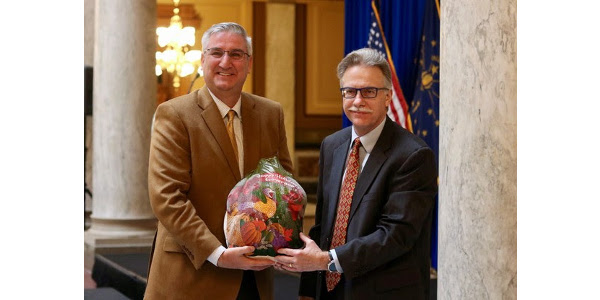 Governor Eric Holcomb and ISPA Executive Vice President Paul Brennan during the Indiana State Poultry Association's annual poultry donation. (Courtesy of Indiana State Department of Agriculture)