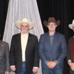 Pictured (L to R) are John Atwater, Netawaka; Joe Scott, manager of Sublette Feeders; and Spencer Crowther and Brant Laue of Laue Charolais, Hanover. (Courtesy of KLA)