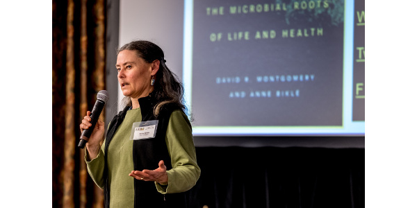 "Anne Biklé, co-author with her husband David Montgomery, of ""The Hidden Half of Nature: The Microbial Roots of Life and Health,"" described her journey into understanding the links between soil health and human health or the soil biome and the human gut biome at the KRC conference in Wichita on Nov. 17. (Courtesy of Kansas Rural Center)"