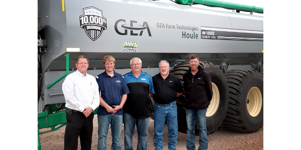 GEA's 10,000th liquid manure spreader unit: EL48 8800 model with a capacity of 10,500 gallons. From left to right: Randy Gorter, head of GEA North America manure management sales; Chris and Paul Winter, PK Winter Farms Inc.; Scott Shane, GEA manure management sales specialist; and Jason Baumgarn, AWS salesman. (Courtesy of GEA)