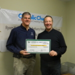Jeff Troike, Ceres Solutions CEO, presenting a check on behalf of Ceres and Land O' Lakes to John Etling of Terre Haute Catholic Charities. (Courtesy of Ceres Solutions)
