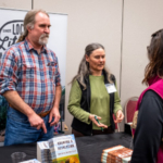 David Montgomery and Anne Bikle, both authors, signed books and spoke with the participants at the KRC November food and farm conference. (Courtesy of Kansas Rural Center)