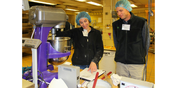 Lindsey and Justin Knopf work through an exercise focused on baking bread, cakes and cookies with different types of wheat in the Shellenberger Hall baking lab. (Courtesy of IGP-KSU)