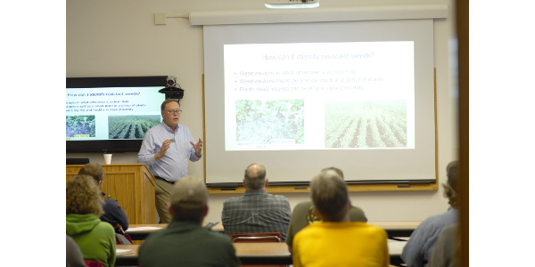 NDSU Extension sugar beet agronomist Tom Peters talks to producers about weed identification. (NDSU photo)