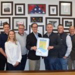 From left to right: Danielle Isaacson, Peter Gillitzer, and Clarissa Levi with the Minnesota Agricultural Water Quality Certification Program; Gary Forsman, Forsman Farms; Minnesota Agriculture Commissioner Dave Frederickson; Peter Forsman and Dave Forsman, Forsman Farms; and, Brad Redlin and Bill Fitzgerald with the Minnesota Agricultural Water Quality Certification Program. (Courtesy of Minnesota Department of Agriculture)