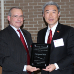 Biological Systems Engineering Department Head David Jones, left, presents Hongwei Xin the Hall of Fame award plaque. (Credit: Amanda Lager, Biological Systems Engineering Department)