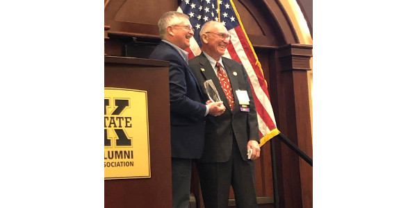 Two Kansas agriculture leaders, Roger Pine of Linwood, and Sharon Schwartz of Washington were honored as recipients of the Kansas Corn Impact Award, presented at the Kansas Corn Symposium on Jan. 23 in Manhattan. (Courtesy of Kansas Corn via Facebook)